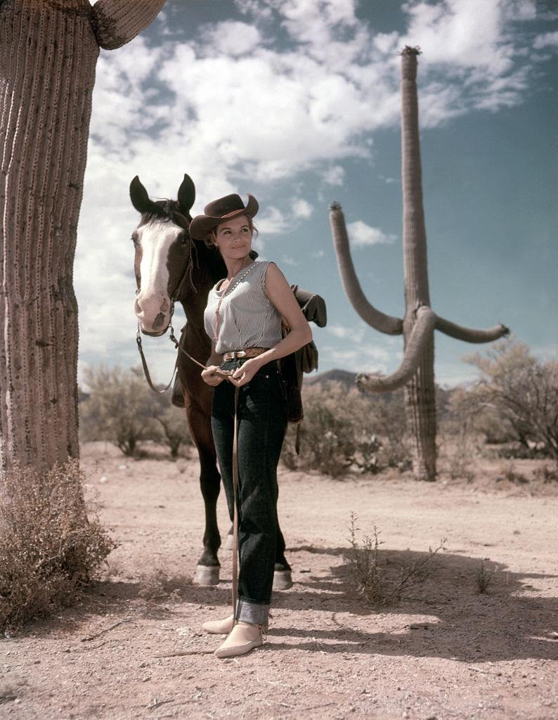 Angie Dickinson with a horse, 1959.