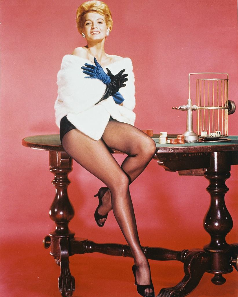 Angie Dickinson poses on a roulette table, 1960.