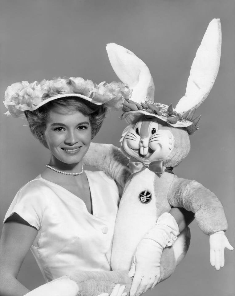 Angie Dickinson takes a break from filming and strikes a pose with 'Bugs Bunny', 1961.
