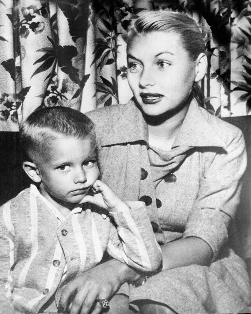 Barbara Payton and her son, Denny, as they arrived in Minneapolis on their way to Cloquet, 1951