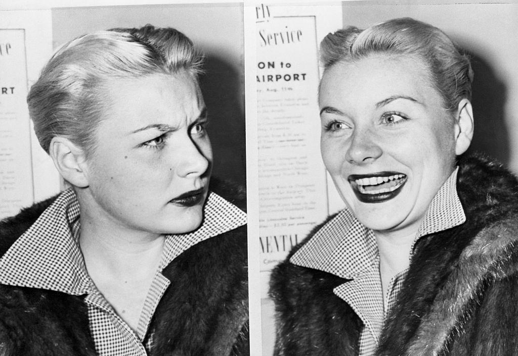 Barbara Payton frowns then laughs as she is interviewed upon her arrival at airport, 1951.