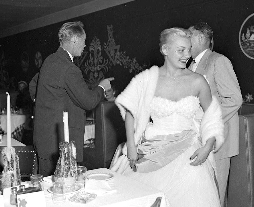 Barbara Payton, leave table in Little Gypsy restaurant, 1951.