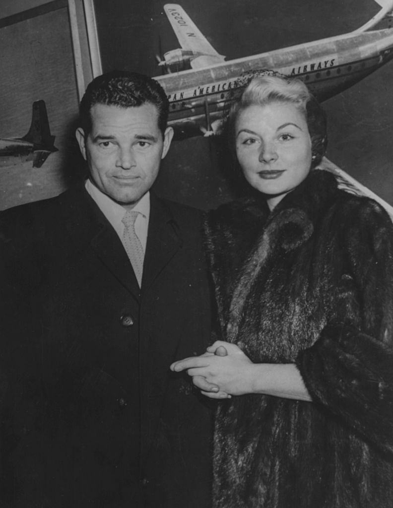 Barbara Payton and Tom Neal pictured on their arrival from England to attend to her son, 1952.