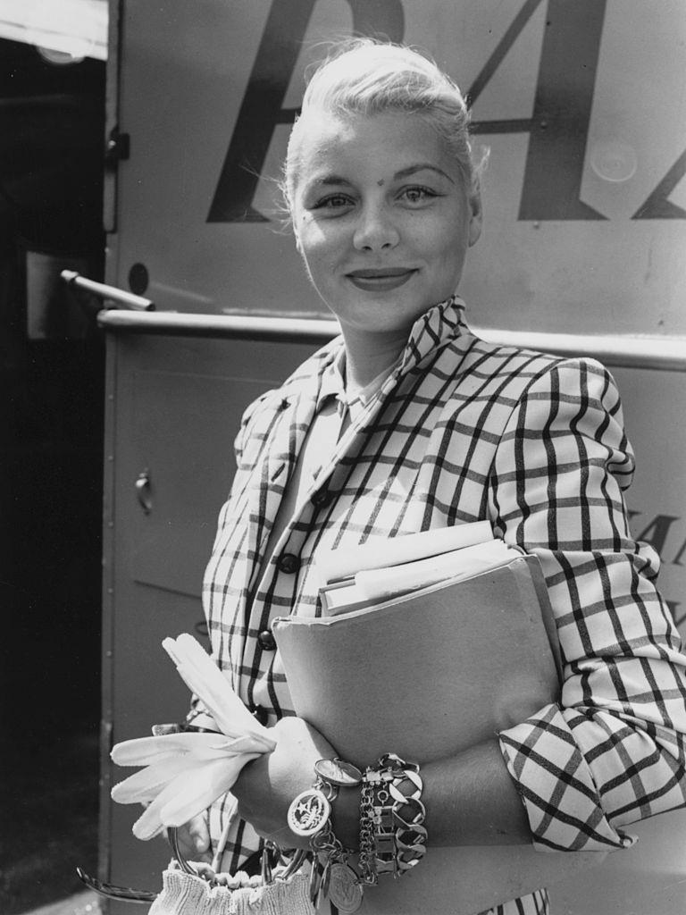 Barbara Payton in the Britain to film 'The Four Sided Triangle', at London Airport, July 24th 1952.