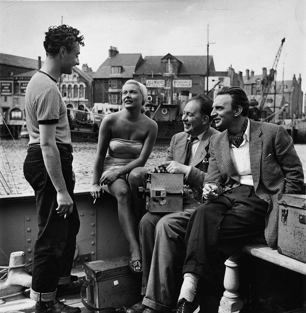 Barbara Payton chats to Michael Carreras producer of a British film, 'The Four Sided Triangle', 1952.