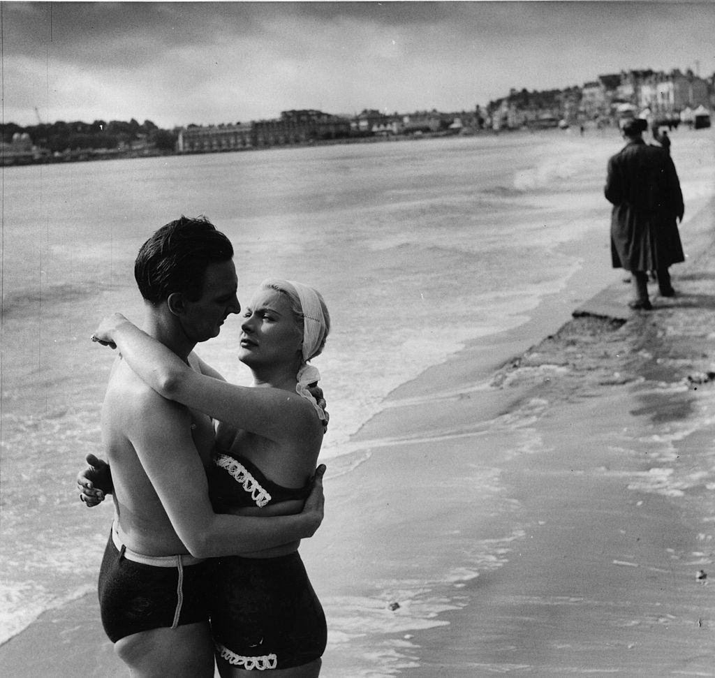 Barbara Payton with Stephen Murray for a scene in a British film, 'The Four Sided Triangle' being shot at Weymouth in Dorset, 1952.