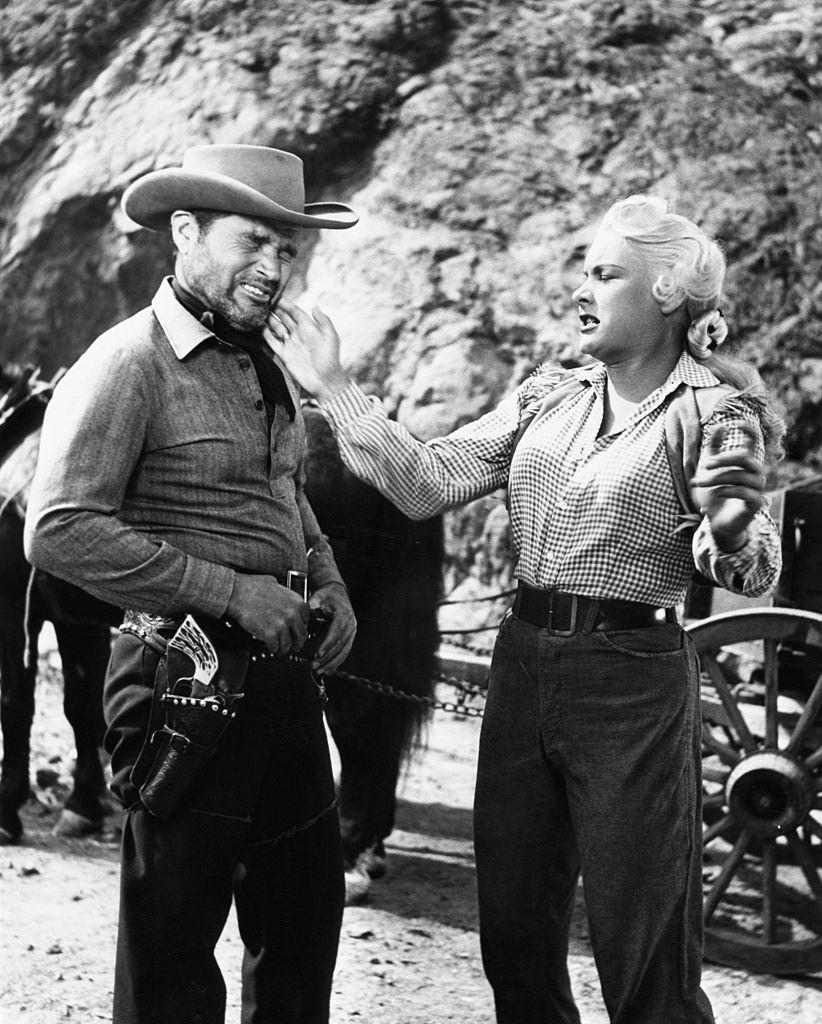 Barbara Payton and Tom Neal in Scenes from 'The Great Jesse James Raid',1953.