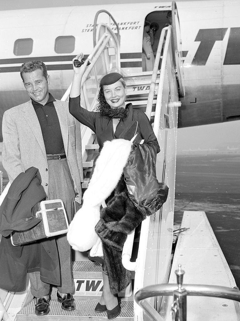 Barbara Payton and Tom Neal arrives at Idlewild Airport, 1953.