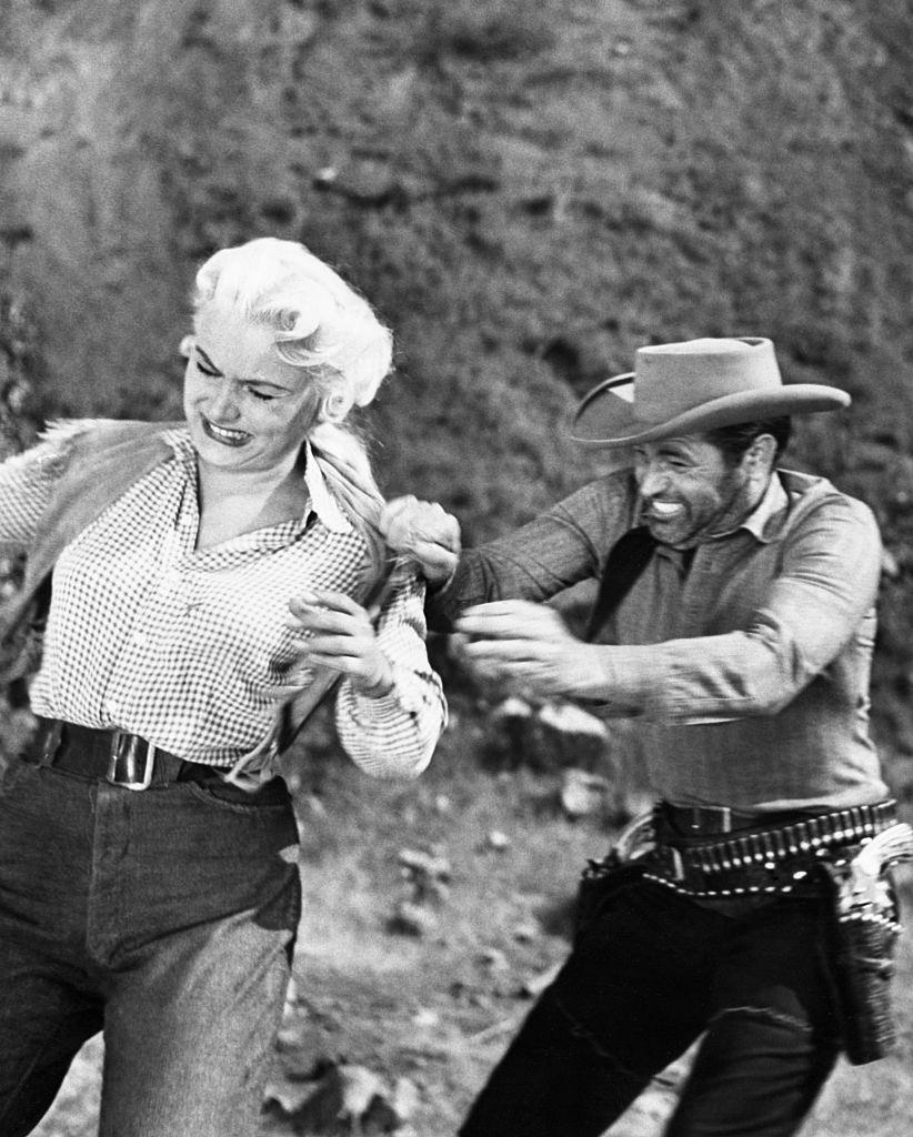 Barbara Payton and Tom Neal in Scenes from 'The Great Jesse James Raid', 1953.