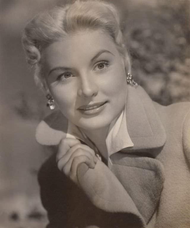 Barbara Payton wearing a coat, 1950.