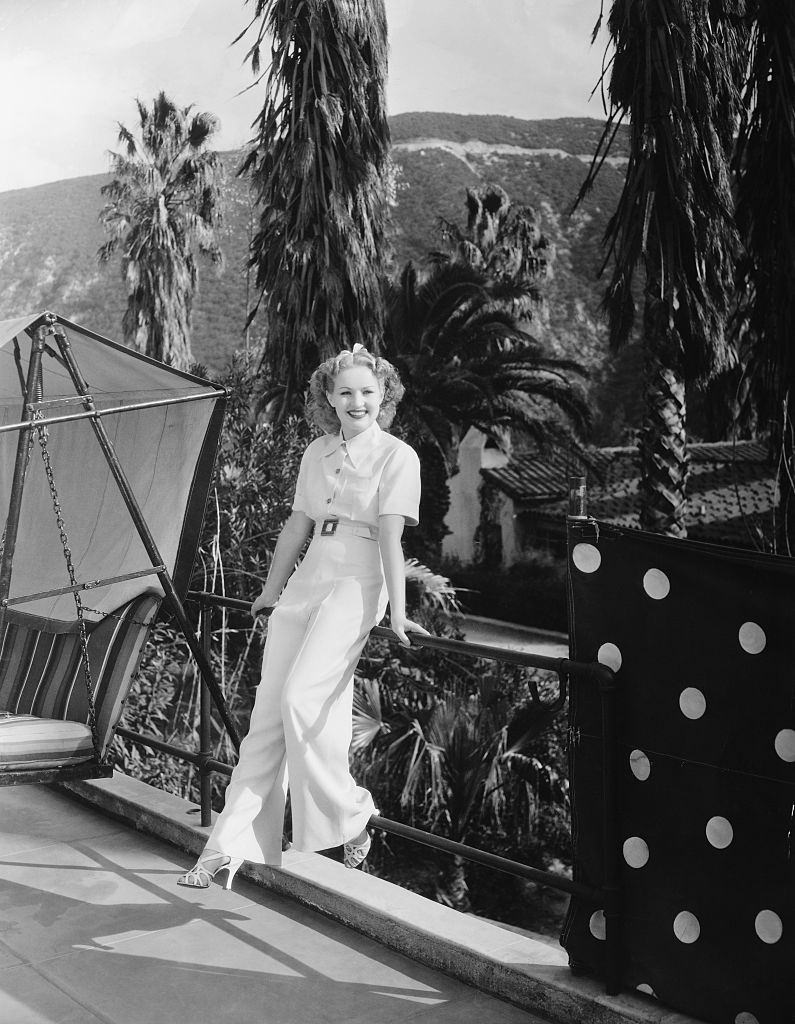 Betty Grable sits on rail, 1973.