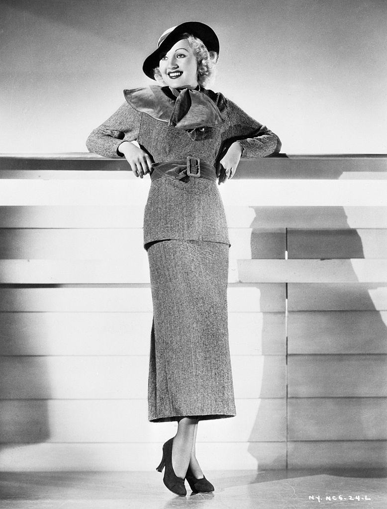 Betty Grable in wool sports dress in black and white pin stripes, 1934.