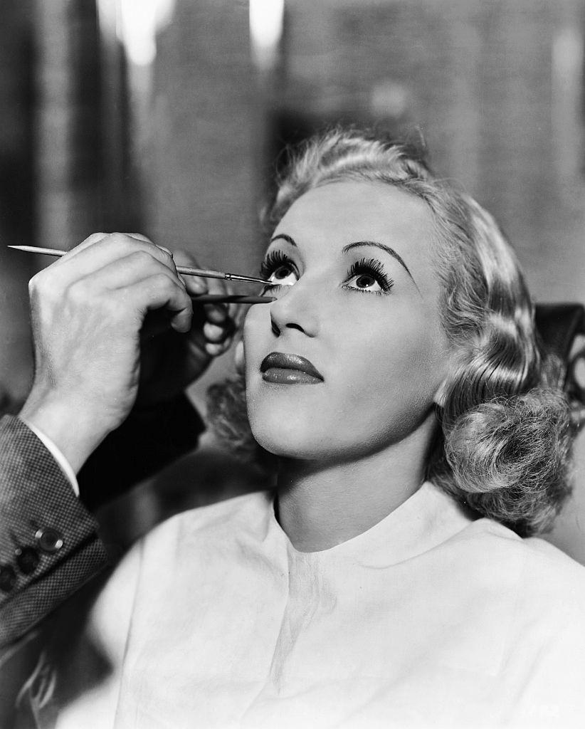 Beautician applying Makeup on Betty Grable, 1937.
