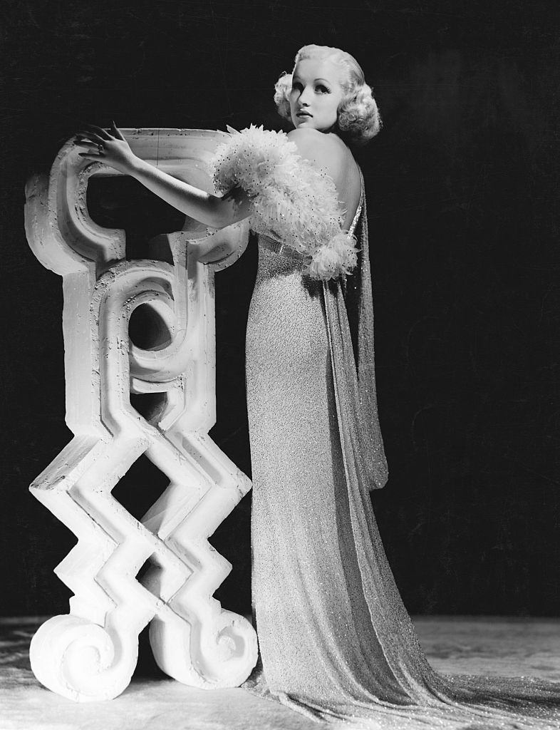Betty Grable wears a beaded chiffon evening gown designed by Edith Head for the 1937 musical 'This Way Please'.