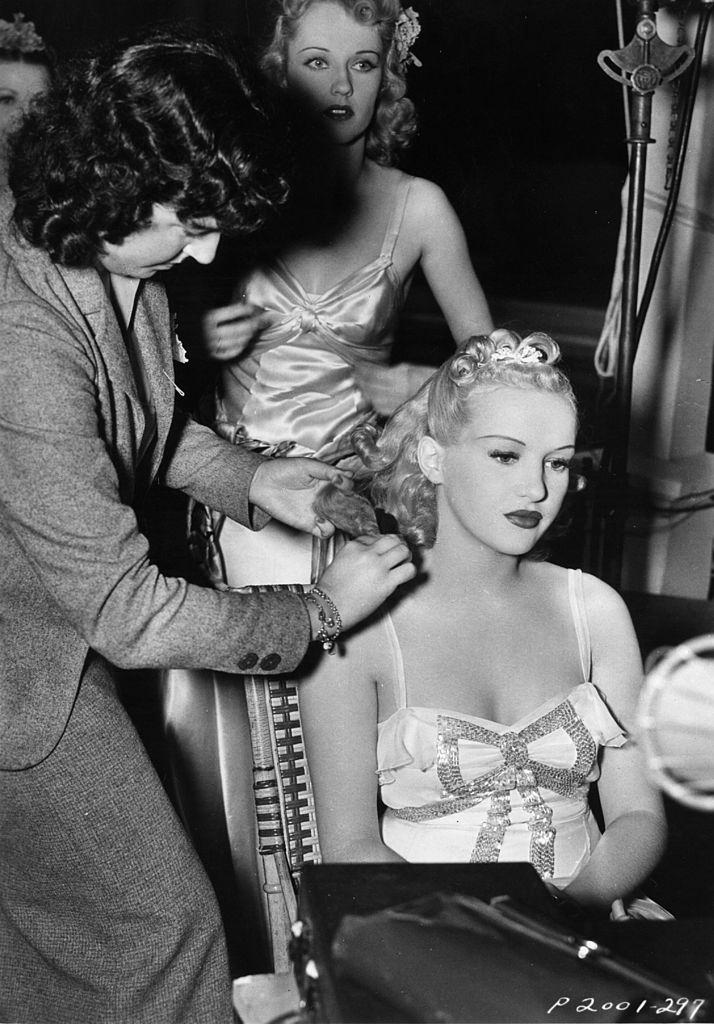 Betty Grable being prepared prior to filming a scene, 1938.