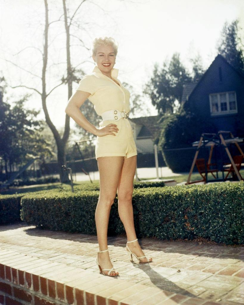 Betty Grable in a yellow playsuit, 1940.