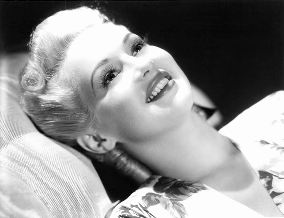 Betty Grable laying back on a pillow in a day dream, 1940.