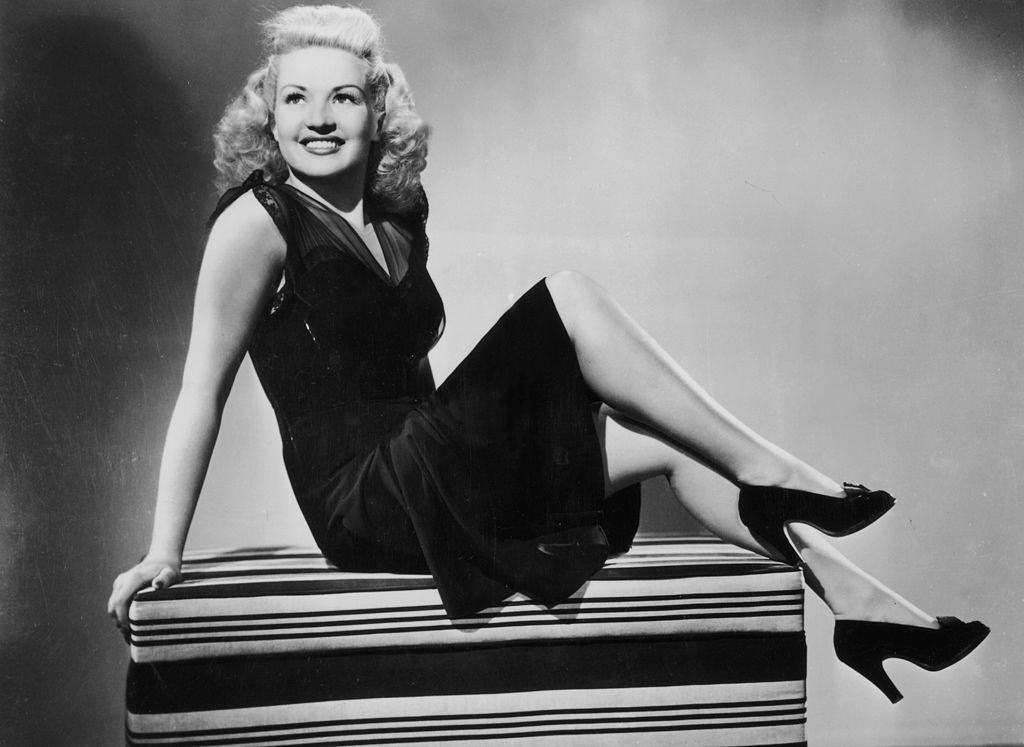 Betty Grable in black dress and high-heeled shoes, 1941.