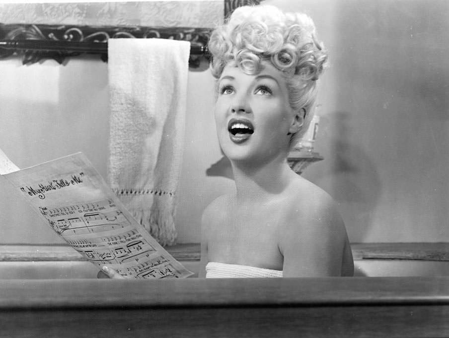 Betty Grable singing from bath tub in a scene from the film 'Sweet Rosie O'Grady', 1943.