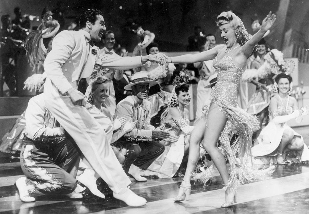 """Betty Grable dancing in scene where she is dancing the """"Jitterbug"""", 1941."""