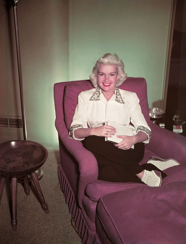 Betty Grable Sitting in Chair, 1950.