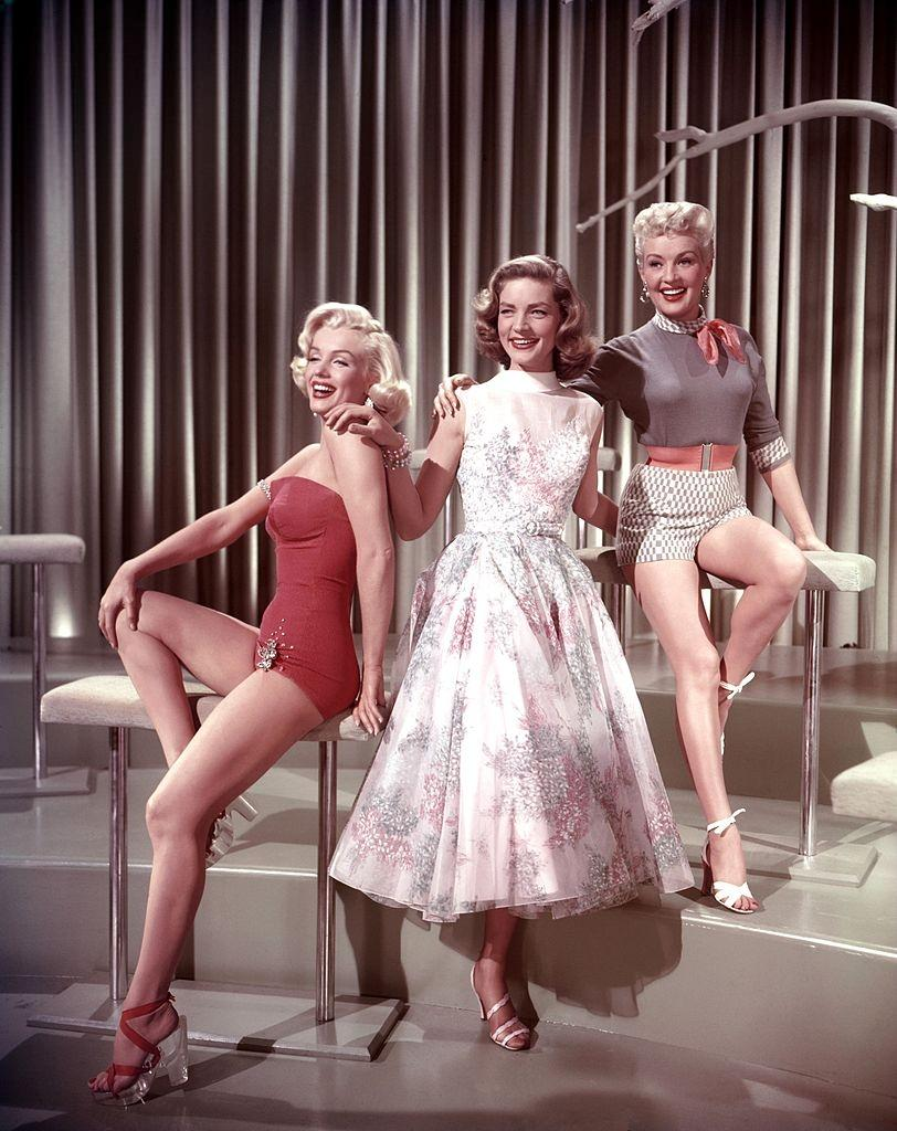 Betty Grable pose with Marilyn Monroe and Lauren Bacall in the movie  'How to Marry a Millionaire', 1953.