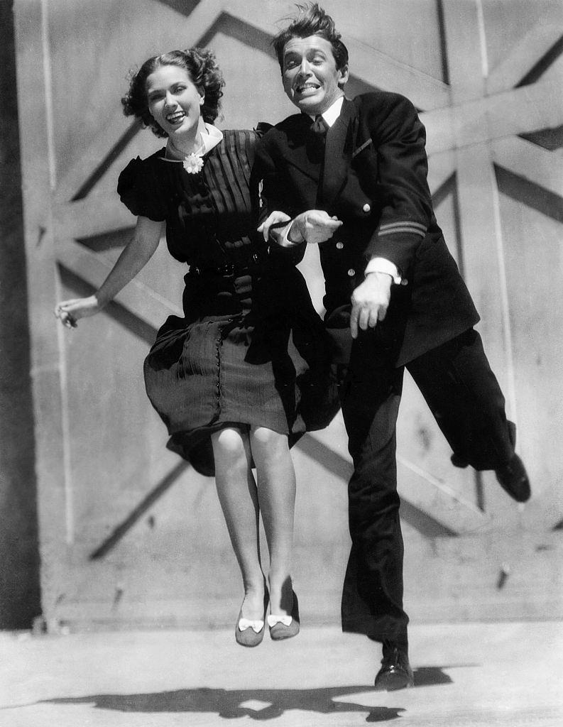 Eleanor Powell with James Stewart during a shooting break, 1937.