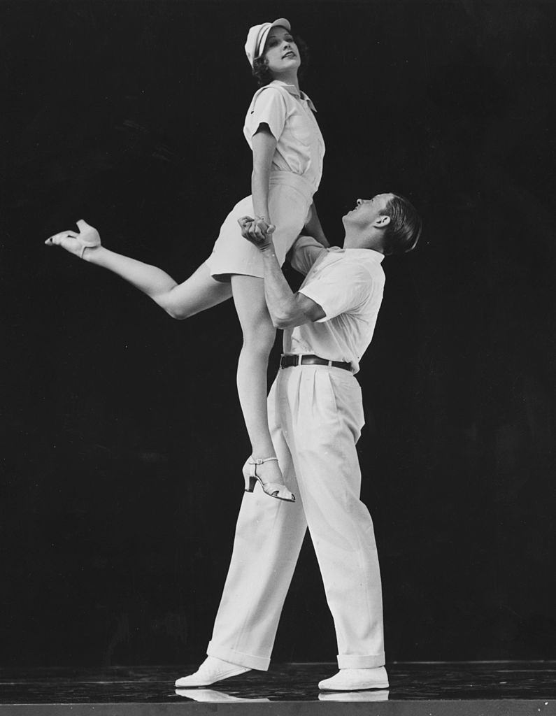 Eleanor Powell and George Murphy dancing in a scene from the MGM musical 'Broadway Melody of 1938'.