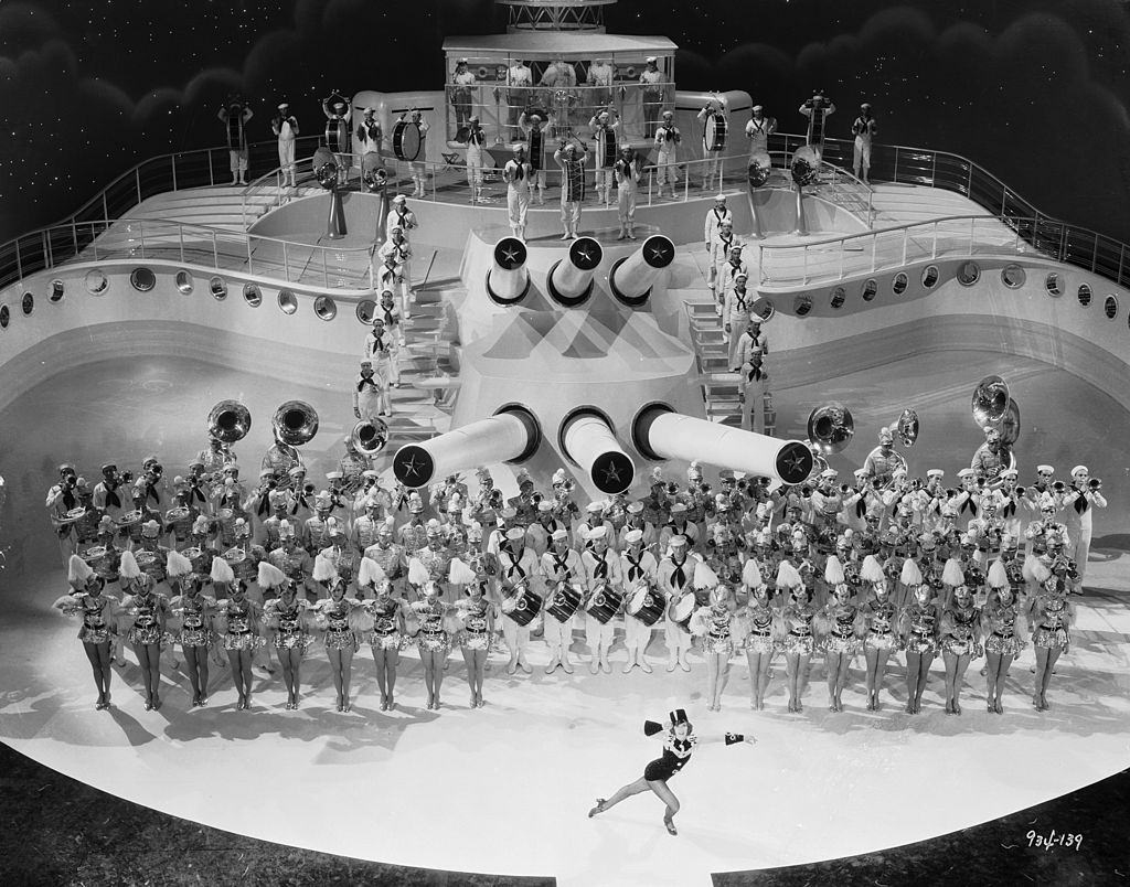 Eleanor Powell performs to the tune of a brass band on the deck of a ship in the musical 'Born To Dance', 1936.