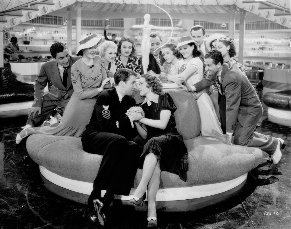 Eleanor Powell and James Stewart  attract a nosy crowd in a scene from the musical 'Born To Dance', 1936.