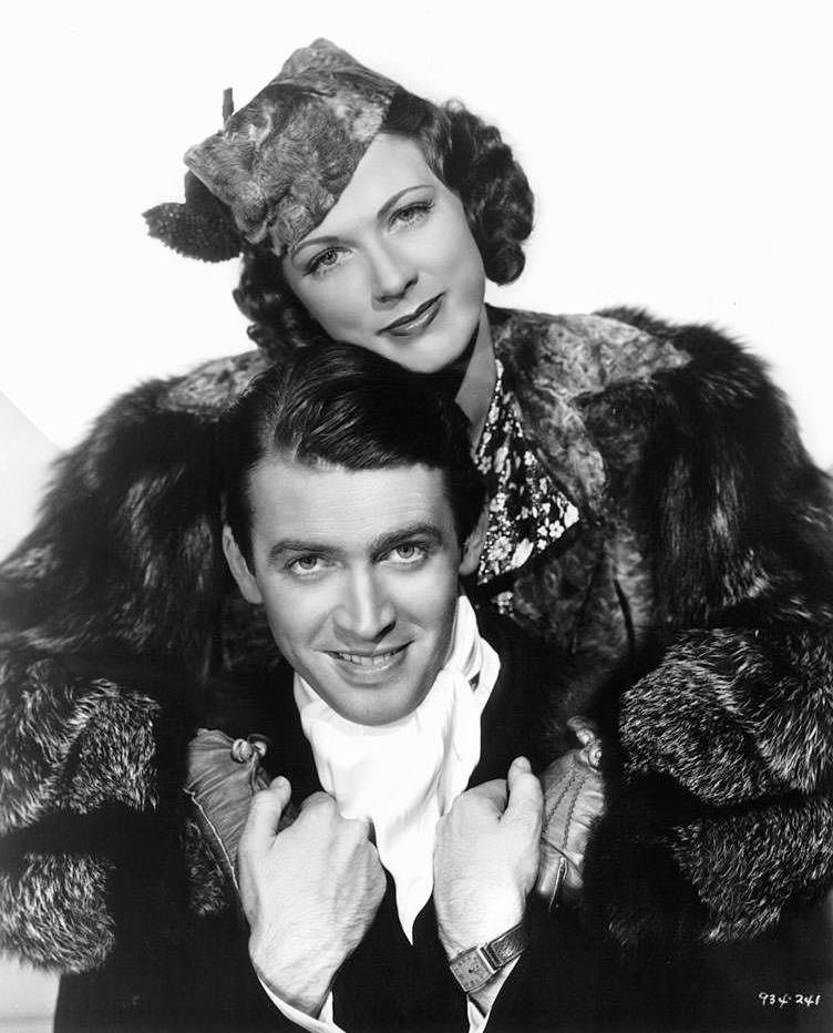 Eleanor Powell has her arms around Jimmy Stewart in a scene from the film 'Born To Dance', 1936.