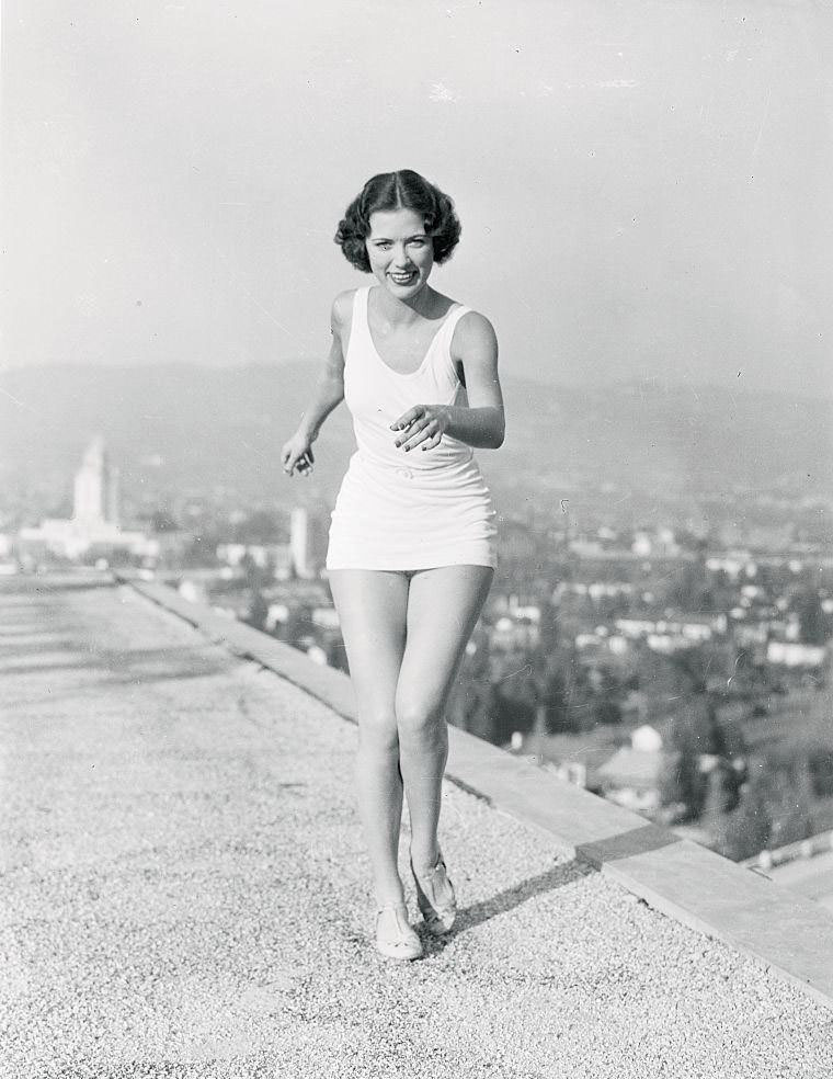 Eleanor Powell practices her intricate routines atop the roof of Hollywood's tallest hotel, 1935.