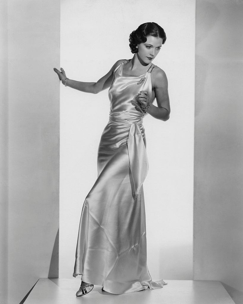 Eleanor Powell wearing a white satin formal gown, 1935.