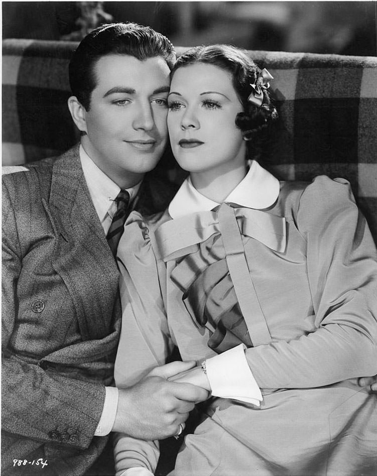 Eleanor Powell and Robert Taylor hold eachother in a scene from the film 'Broadway Melody Of 1936'.