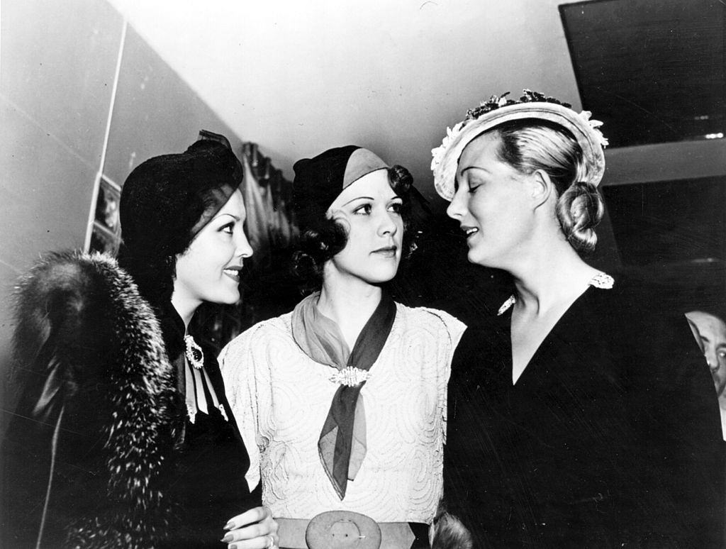 Eleanor Powell with Raquel Torres, and Binnie Barnes, join each other for tea at the Trocadero, 1934.