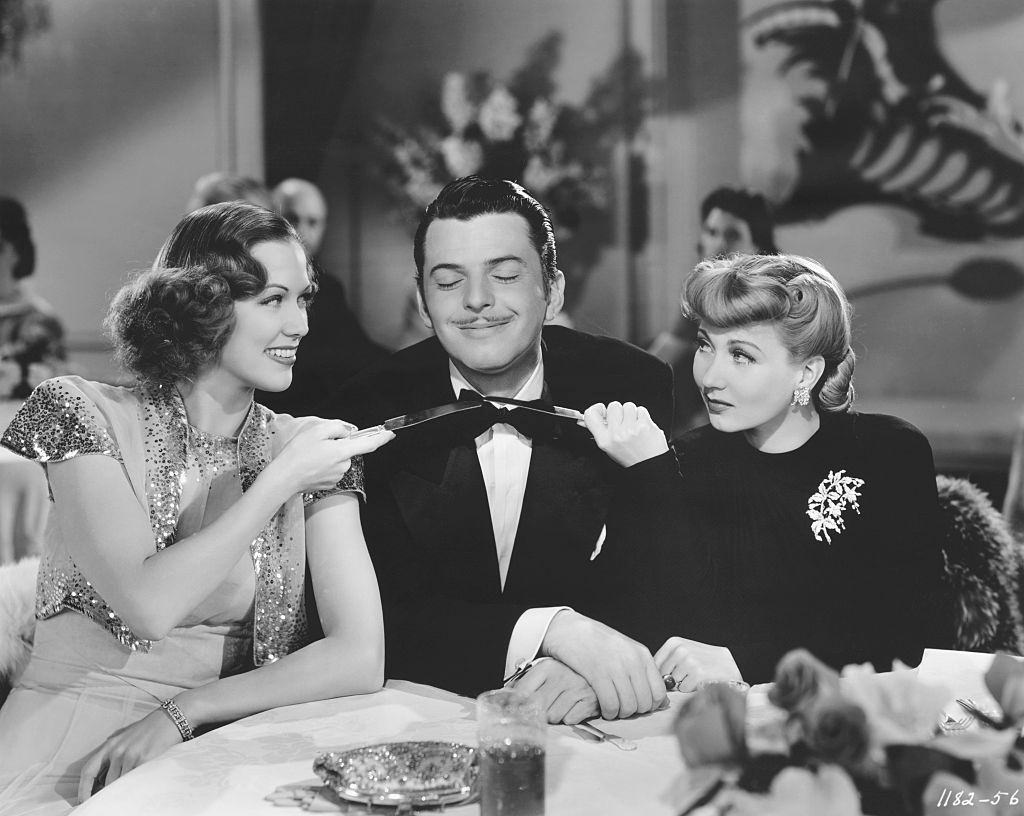 Eleanor Powell with Ann SOrther and Buddy Crawford at the restaurant, 1941.