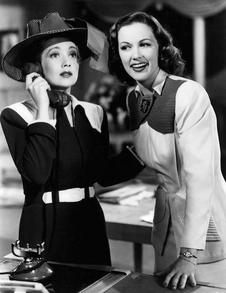 Ann Sothern on the phone while Eleanor Powell listens in a scene from the film 'Lady Be Good', 1941.