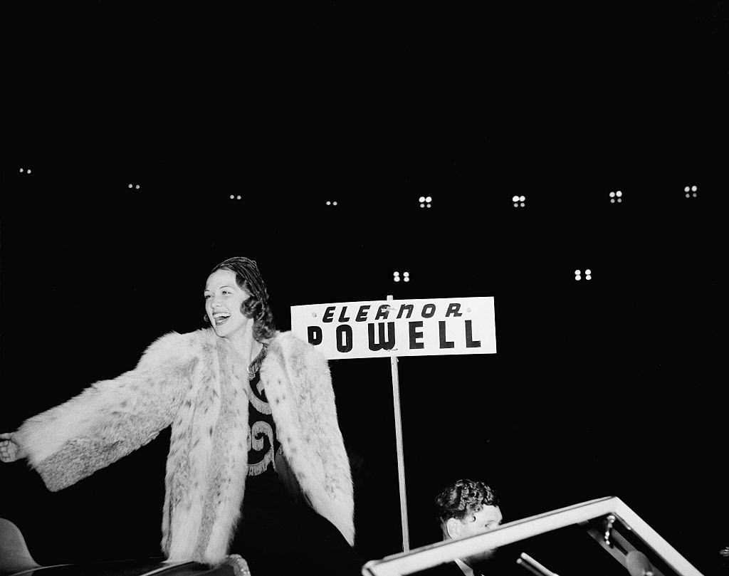 Eleanor Powell greets fans during the Hollywood Chirstmas Parade in Los Angeles, 1940.