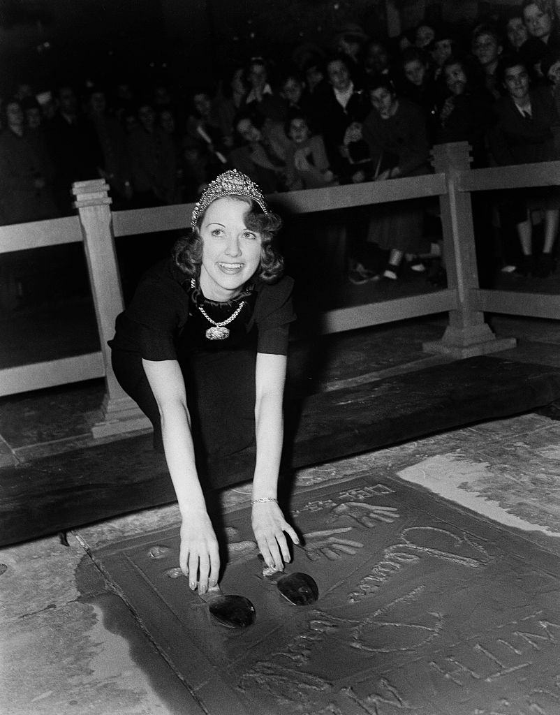 Eleanor Powell has her hands added to cement in front of Grauman's Chinese Theatre in Los Angeles, 1973.