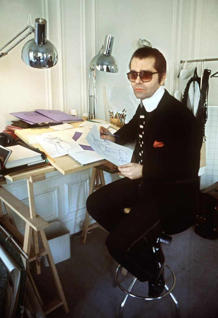 Karl Lagerfeld  sits at his desk in 1979.
