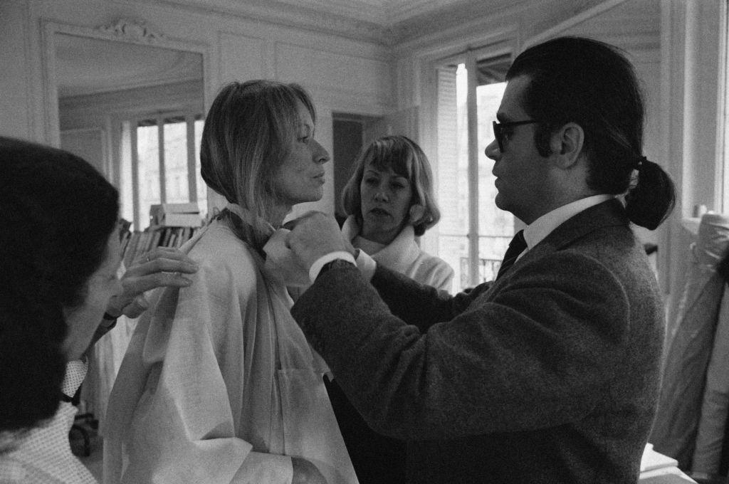 Karl Lagerfeld fixing a model's collar, 1979.