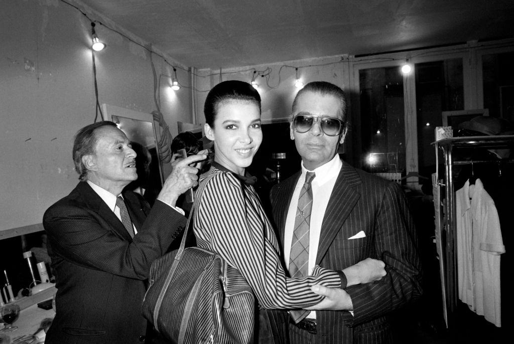 Karl Lagerfeld with a model as French hairdresser Alexandre de Paris, 1983.