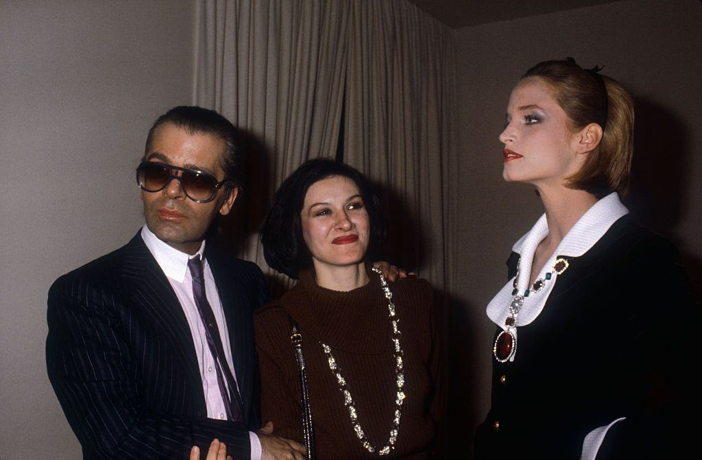 Karl Lagerfeld with designer Paloma Picasso and a fashion model at the Chanel Spring-Summer 1983.