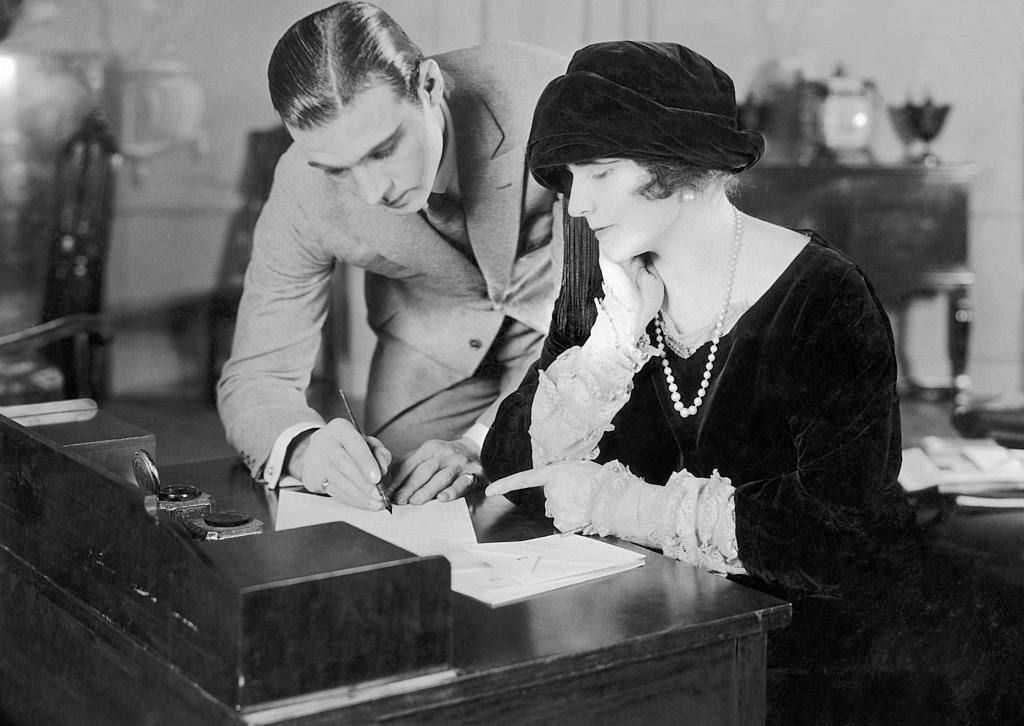 Rudolph Valentino and the actress Natache Rambova signing the register on their Wedding Day, 1923.