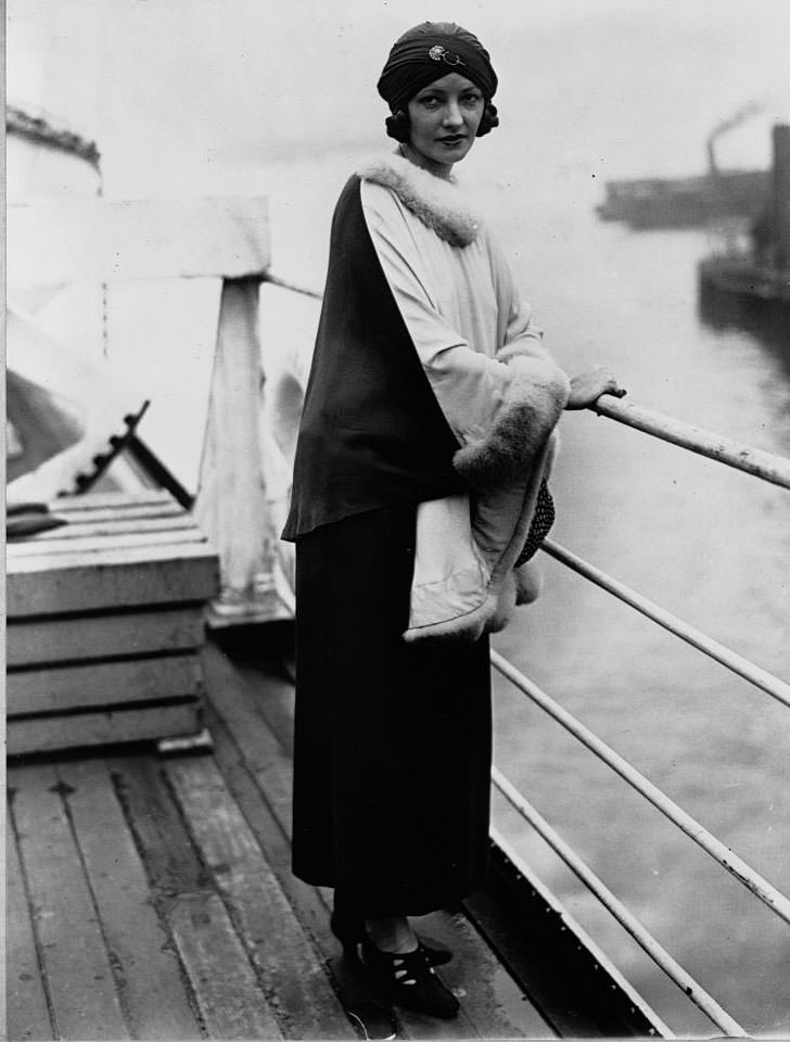 Natacha Rambova stands on the deck of the Paris as she sails to Europe on vacation. September 13, 1925.