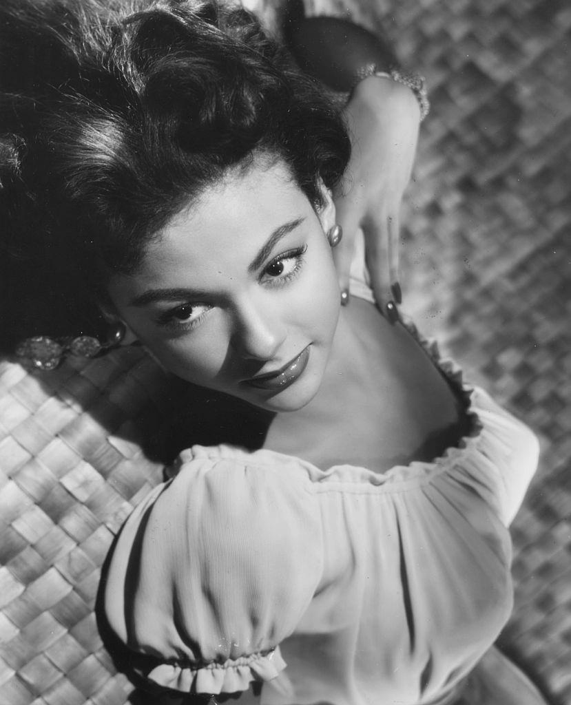 Rita Moreno reclining backwards, from the movie 'Cattle Town', 1952.