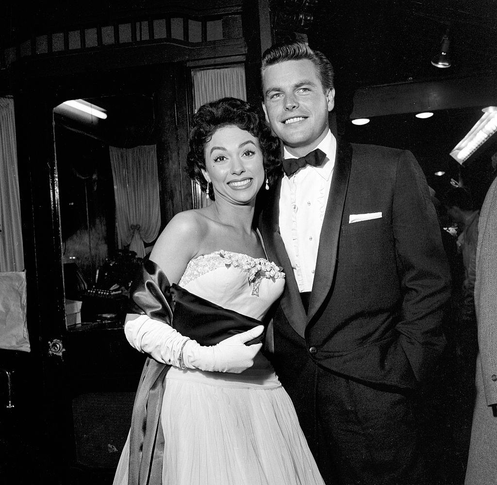 """Rita Moreno and Robert Wagner attend the movie premiere of """"Grey Flannel Suit"""", 1955."""