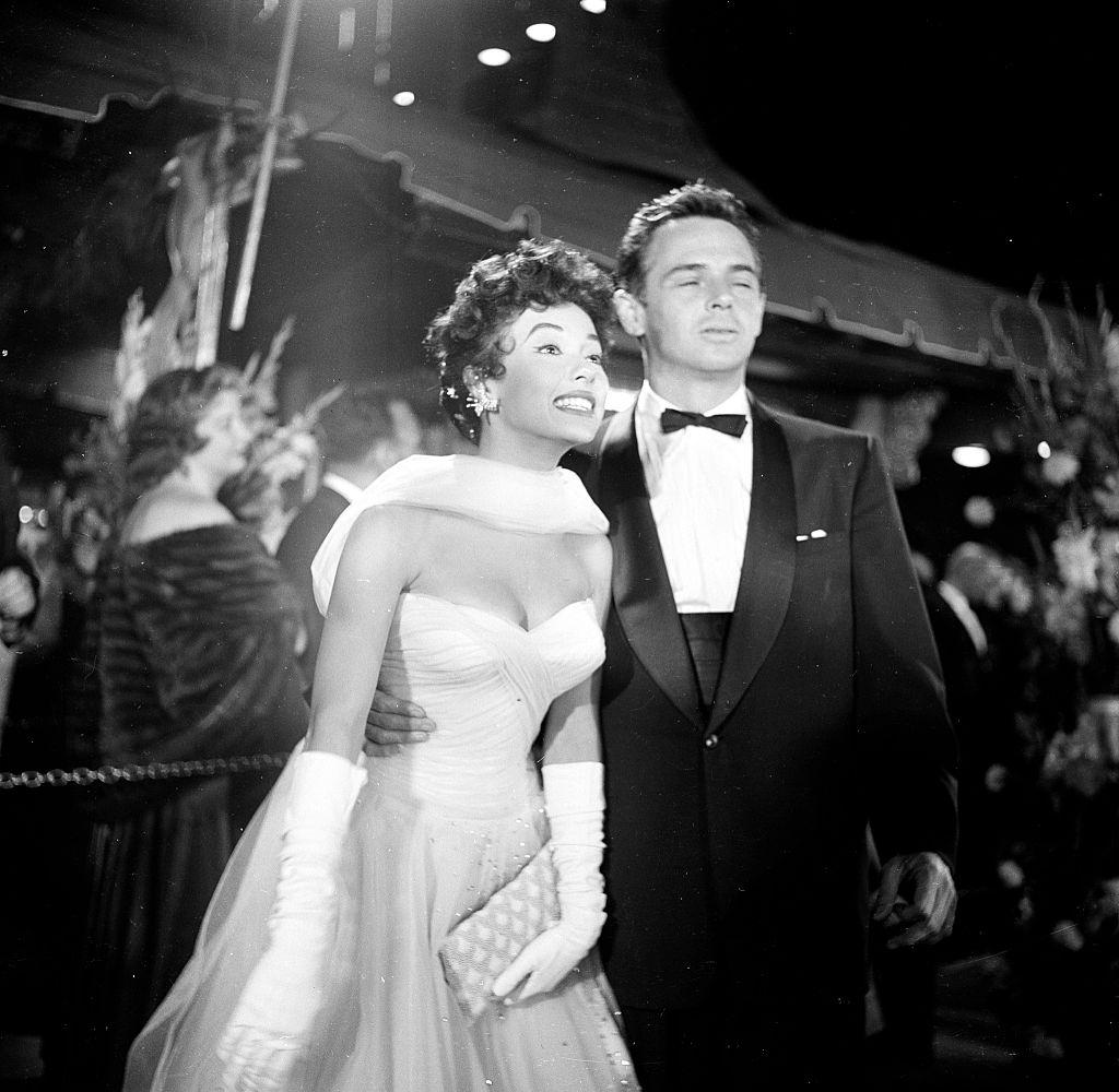 Rita Moreno and John Hudson attend the movie premiere of the 'Egyptian', 1954.