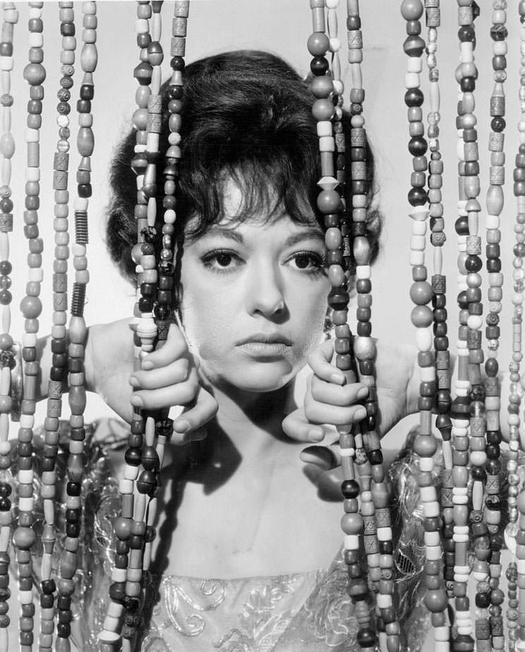 Rita Moreno behind a beaded curtain in a scene from the film 'A Summer And Smoke', 1961.