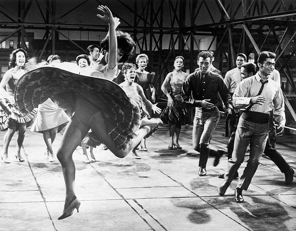Rita Moreno dancing with cast of West Side Story, 1961.